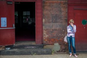 Artist Larissa Eremeeva smoking a cigarette outside the Art Factory in Paterson, New Jersey